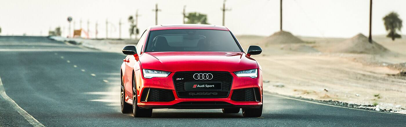 RS7__sport_performance_sportback_audi_red_front_1400x438.jpg